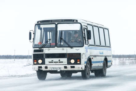 Novyy Urengoy, Russia - May 8, 2016: Bus PAZ 3205 at the interurban road during a heavy northern blizzard.