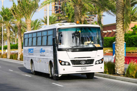 Dubai, UAE - November 16, 2018: Whtie bus Tata LPO 1618 in the city street. 에디토리얼