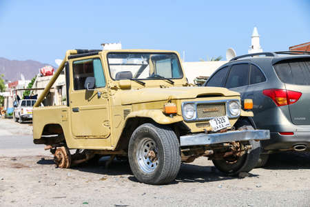 Fujairah, UAE - November 18, 2018: Broken off-road vehicle Toyota Land Cruiser 40 in the city street.