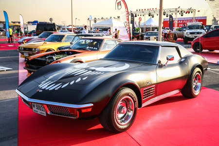 Dubai, UAE - November 15, 2018: Black sportscar Chevrolet Corvette Stingray takes part in the annual Gulf Car Festival.