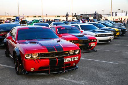 Dubai, UAE - November 15, 2018: Muscle cars Dodge Challenger take part in the annual Gulf Car Festival.