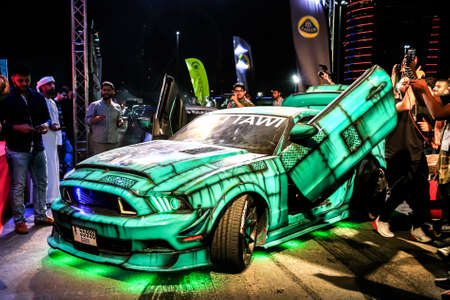 Dubai, UAE - November 15, 2018: Muscle car Ford Mustang takes part in the annual Gulf Car Festival.