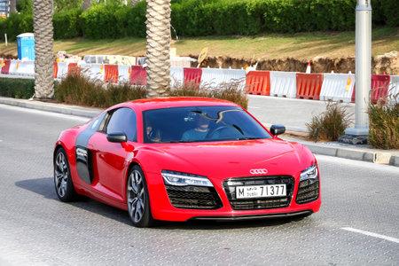 Dubai, UAE - November 16, 2018: Red sportscar Audi R8 in the city street.