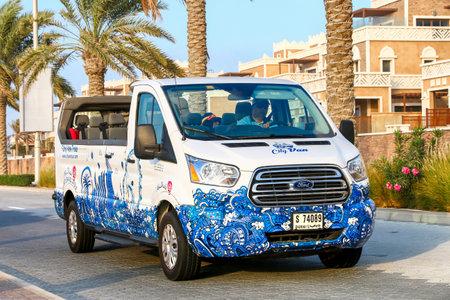 Dubai, UAE - November 18, 2018: Touristic convertible van Ford Transit in the city street.