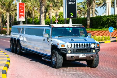 Dubai, UAE - November 15, 2018: White limousine Hummer H2 in the city street. Editöryel
