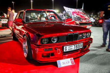Dubai, UAE - November 15, 2018: Red sportscar BMW (E30) M3 takes part in the annual Gulf Car Festival. Editorial