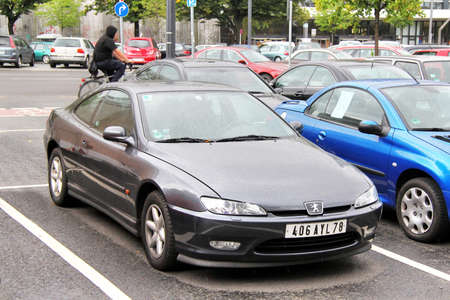 Berlin, Germany - September 10, 2013: Motor car Peugeot 406 Coupe in the city street. Redakční