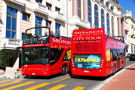 Monte-Carlo, Monaco - March 12, 2019: Red sightseeing buses Ayats Bravo I in the city street. Editorial
