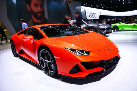 Geneva, Switzerland - March 11, 2019:  Orange supercar Lamborghini Huracan Evo presented at the annual Geneva International Motor Show 2019.