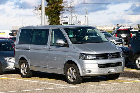 Geneva, Switzerland - March 11, 2019: Passenger van Volkswagen Transporter in the city street.