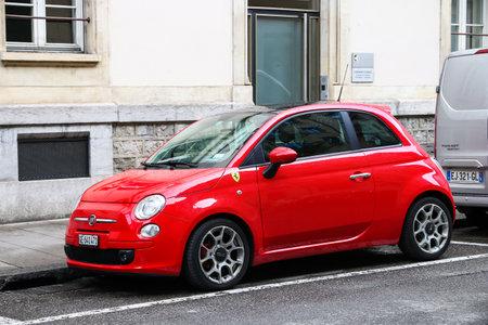 Geneva, Switzerland - March 13, 2019: Red motor car Fiat 500 in the city street.