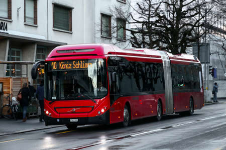 Bern, Switzerland - March 13, 2019: Articulated city bus Volvo 7900A Hybrid in the city street.