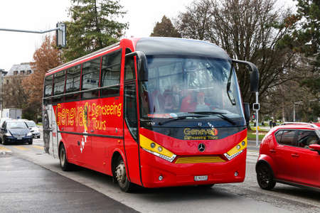 Geneva, Switzerland - March 13, 2019: City sightseeing bus UNVI Touring GT in the city street.