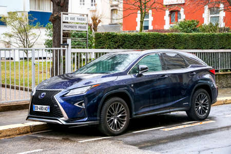 Grenoble, France - March 14, 2019: Motor car Lexus RX in the city street.