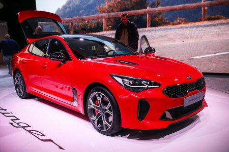 Geneva, Switzerland - March 11, 2019: Red motor car Kia Stinger presented at the annual Geneva International Motor Show 2019.