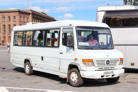 Saint Petersburg, Russia - May 25, 2013: White sightseeing bus Mercedes-Benz Vario 614D in the city street.