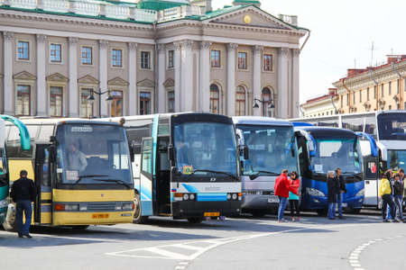 Saint Petersburg, Russia - May 25, 2013: City sightseeing coach buses parking near the Saint Isaacs Square - popular landmark of the city.