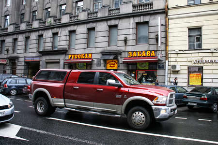 Saint Petersburg, Russia - May 26, 2013: Bright pickup truck Dodge Ram 3500 Heavy Duty in the city street.