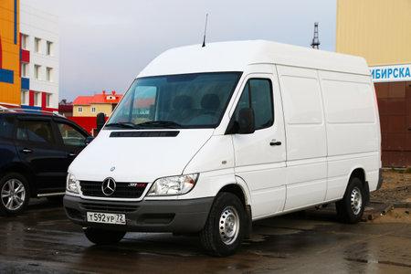 Novyy Urengoy, Russia - June 15, 2019: White cargo van Mercedes-Benz Sprinter 311CDI in the city street.