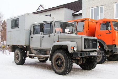 Novyy Urengoy, Russia - October 27, 2012: Off-road truck GAZ-3325 Yeger in the city street. Sajtókép