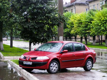 Asha, Russia - June 28, 2007: Red motor car Renault Megane in the city street.