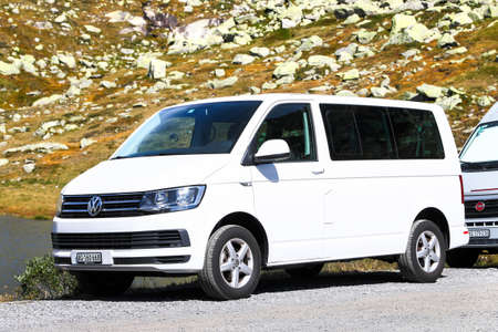 Saint Gotthard Pass, Switzerland - September 14, 2019: White passenger van Volkswagen Transporter at the countryside. Editorial