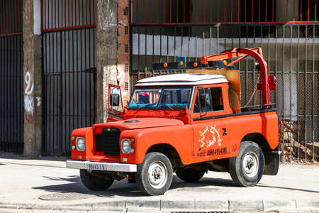 Casablanca, Morocco - September 29, 2019: Red tow truck Land Rover Santana Series III in the city street. Editorial