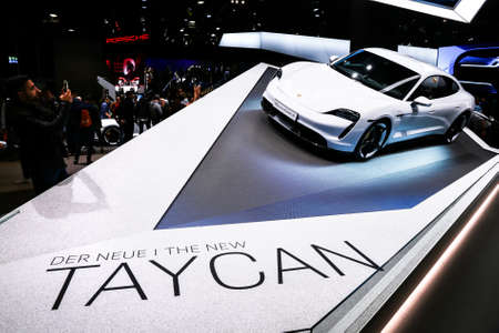 Frankfurt am Main, Germany - September 18, 2019: All-electric coupe car Porsche Taycan Turbo S at the Frankfurt Motor Show IAA 2019 (Internationale Automobil Ausstellung). 報道画像