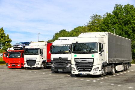 Bourgogne-Franche-Comte, France - September 14, 2019: Semi-trailer trucks DAF XF and Mercedes-Benz Actros at the interurban road. Sajtókép