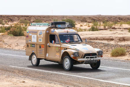 Oued Amerbouh, Morocco - September 26, 2019: Retro car Citroen Acadiane takes part in the 2CV Maroc Dunas Raid IV Edition.