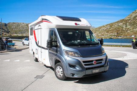 Saint Gotthard Pass, Switzerland - September 13, 2019: Grey and white caravan car Buerstner Ixeo Time it 726 Bantam (Fiat Ducato) at the countryside. Redakční