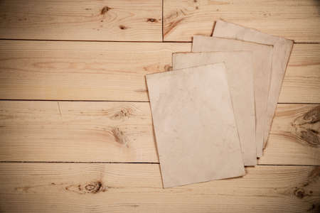 Old paper sheets laying on the wooden table