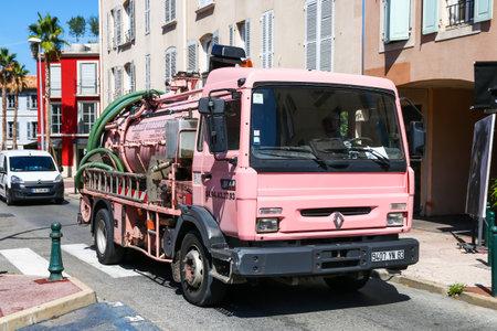 Saint-Tropez, France - September 11, 2019: Pink sanitary truck Renault Midliner in the city street. Editorial