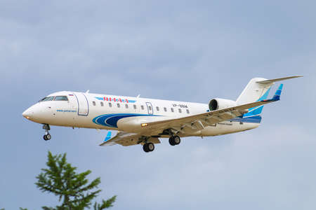 Novyy Urengoy, Russia - July 6, 2019: Yamal Airlines Bombardier CRJ-200LR arrives to the Novyy Urengoy airport. Éditoriale