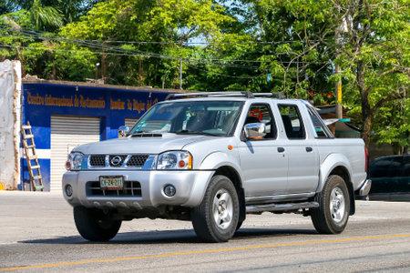 Palenque, Mexico - May 22, 2017: Grey pickup truck Nissan Navara in the city street. Editorial