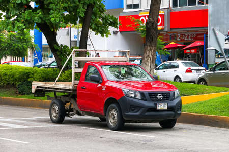 Acapulco, Mexico - May 30, 2017: Red pickup truck Nissan Navara in the city street. Editorial