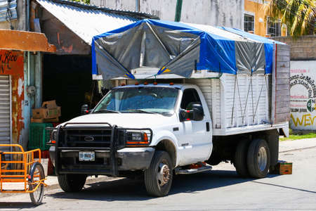 Tulum, Mexico - May 17, 2017: White agricultural truck Ford F-450 Super Duty in the city street.
