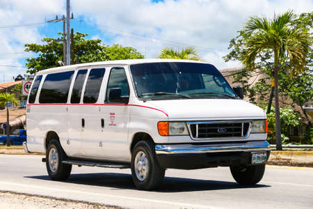 Tulum, Mexico - May 17, 2017: White passenger van Ford Econoline in the city street.