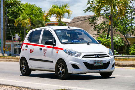 Tulum, Mexico - May 17, 2017: White taxi car Hyundai i10 in the city street. Editorial