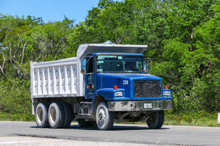 Tulum, Mexico - May 17, 2017: Blue dump truck Volvo WG in the city street.