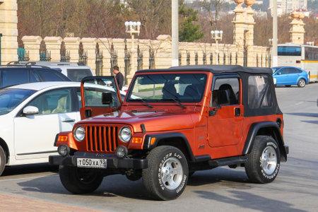 Anapa, Russia - November 16, 2014: Offroad SUV car Jeep Wrangler in the city street.