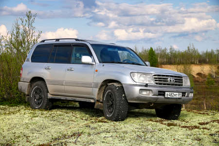 Novyy Urengoy, Russia - May 22, 2020: Grey offroad car Toyota Land Cruiser 100 in the northern tundra. Editorial