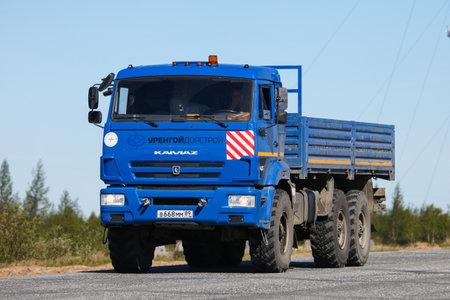 Novyy Urengoy, Russia - June 6, 2020: Blue offroad truck Kamaz 43118 at the interurban road.