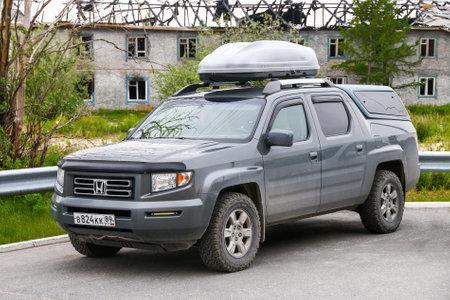 Novyy Urengoy, Russia - June 13, 2020: Pickup truck Honda Ridgeline in the city street. Editoriali