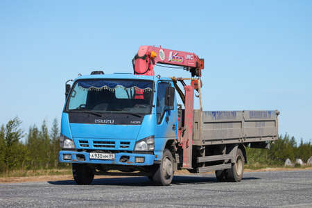 Novyy Urengoy, Russia - June 4, 2020: Manipulator truck Isuzu NQR at the interurban road.