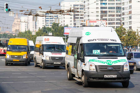 Chelyabinsk, Russia - July 18, 2012: Fixed route taxis Ford Transit in the city street.