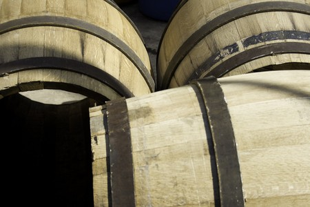 macerated: Three wine barrels lying on the ground