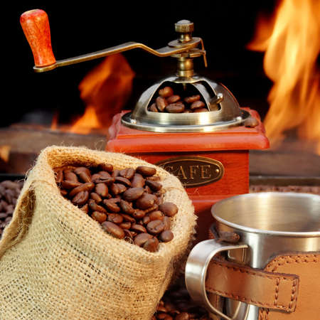 Coffee Mug, coffee beans   and grinder  Open fire photo