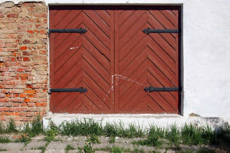 Ancient wooden gate in old building facade  Background, with space for text or image  photo