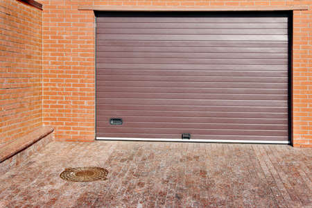 Automatic Rolling Garage Gate and brick fence photo